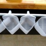 Old milk containers used as storage bins